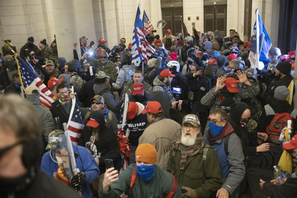 Watching footage of pro-Trump rioters, seen here inside the U.S. Capitol, can be highly stressful, explain experts on trauma. (Photo: Win McNamee/Getty Images)