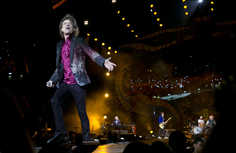 """FILE - In this March 25, 2016 file photo, Rolling Stones frontman Mick Jagger performs in Havana, Cuba. The Rolling Stones are releasing a new version of their 1973 album """"Goats Head Soup"""" with three unheard tracks. One of the new tracks is called """"Scarlet"""" and features Led Zeppelin guitarist Jimmy Page. The album coming out on Sept. 4, 2020 will have a four-disc CD and vinyl box set edition with ten bonus tracks. The Stones also released a video for one of the unheard songs, called """"Criss Cross."""" (AP Photo/Enric Marti, File)"""