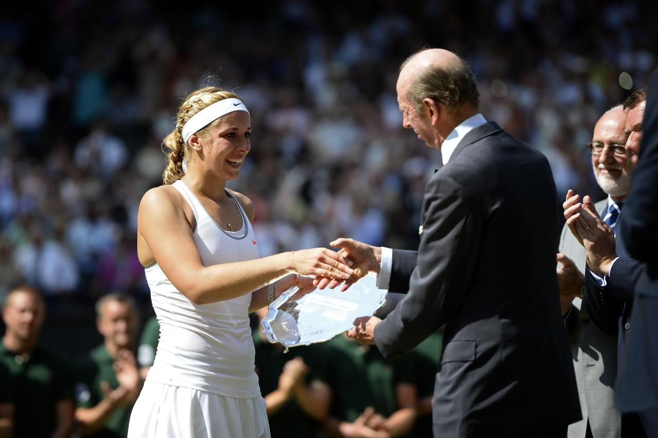 LONDON, ENGLAND - JULY 06: Sabine Lisicki of Germany receives her runner-up trophy from Prince Edward, Duke of Kent on Centre Court after her Ladies' Singles final match against Marion Bartoli of France on day twelve of the Wimbledon Lawn Tennis Championships at the All England Lawn Tennis and Croquet Club on July 6, 2013 in London, England. (Photo by Dennis Grombkowski/Getty Images)