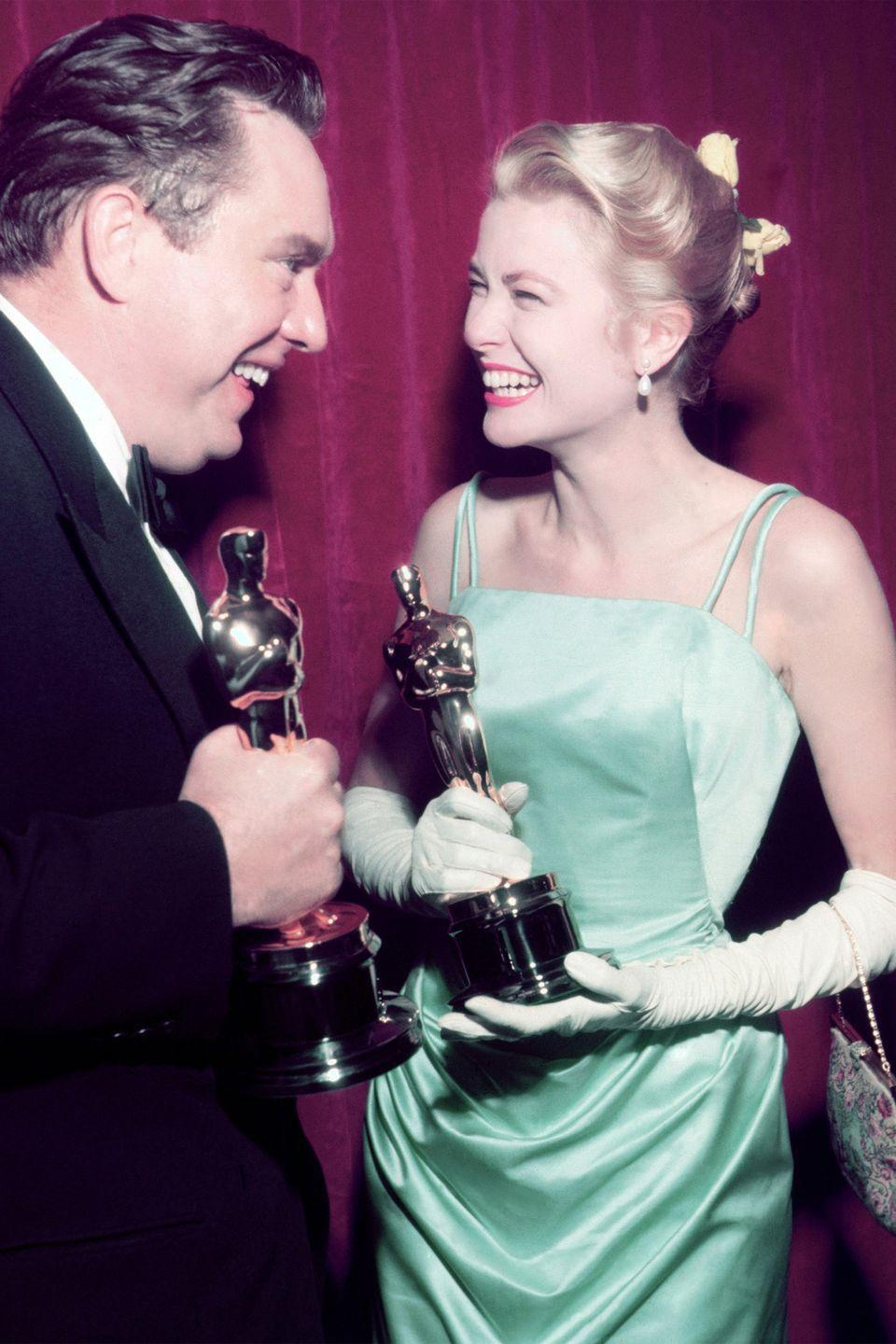 <p>Winning Best Actress for <em>The Country Girl</em>, Grace Kelly proved that a smile is your best accessory for a vibrant Givenchy gown. </p>