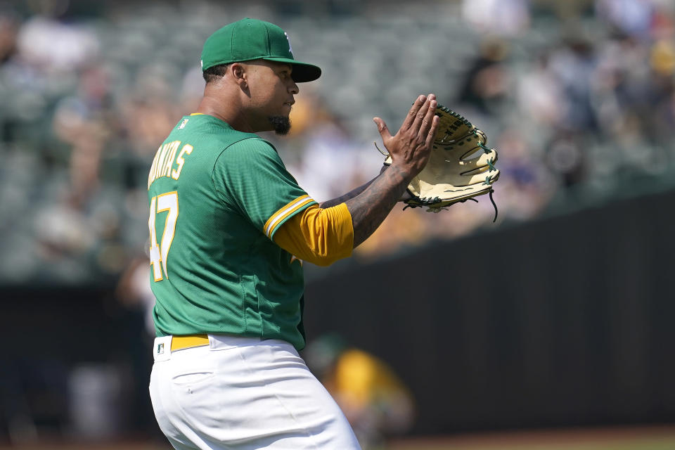 Oakland Athletics pitcher Frankie Montas reacts after New York Yankees' Joey Gallo hit into a double play during the seventh inning of a baseball game in Oakland, Calif., Saturday, Aug. 28, 2021. (AP Photo/Jeff Chiu)