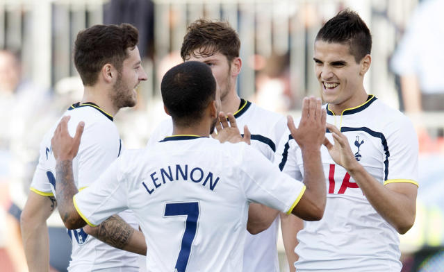 Tottenham Hotspur's Erik Lamela, right, celebrates his first goal of a friendly soccer game with teammates, from left to right, Ryan Mason, Aaron Lennon and Ben Davies during the first half against Toronto FC in Toronto on Wednesday, July 23, 2014. (AP Photo/The Canadian Press, Darren Calabrese)