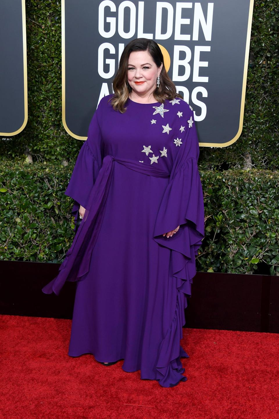 """<p>Wearing a Reem Acra dress <a rel=""""nofollow noopener"""" href=""""https://11honore.com/collections/reem-acra/products/reem-acra-purple-georgette-caftan-with-ruffle"""" target=""""_blank"""" data-ylk=""""slk:that's available at 11 Honoré"""" class=""""link rapid-noclick-resp"""">that's available at 11 Honoré</a> with Chopard jewels.</p>"""