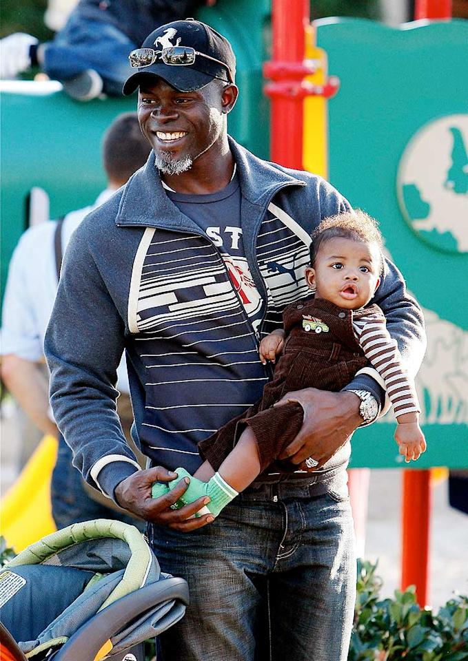 """Djimon is clearly a proud papa! Trico/<a href=""""http://www.x17online.com"""" target=""""new"""">X17 Online</a> - November 22, 2009"""