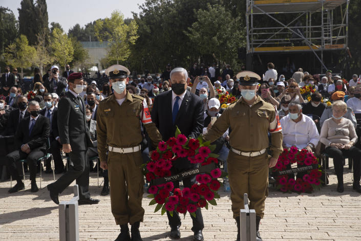 Israeli Prime Minister Benjamin Netanyahu prepares to lay a wreath at a ceremony marking the annual Holocaust Remembrance Day at Yad Vashem Holocaust Memorial in Jerusalem, Thursday, April 8, 2021. (AP Photo/Maya Alleruzzo, Pool)