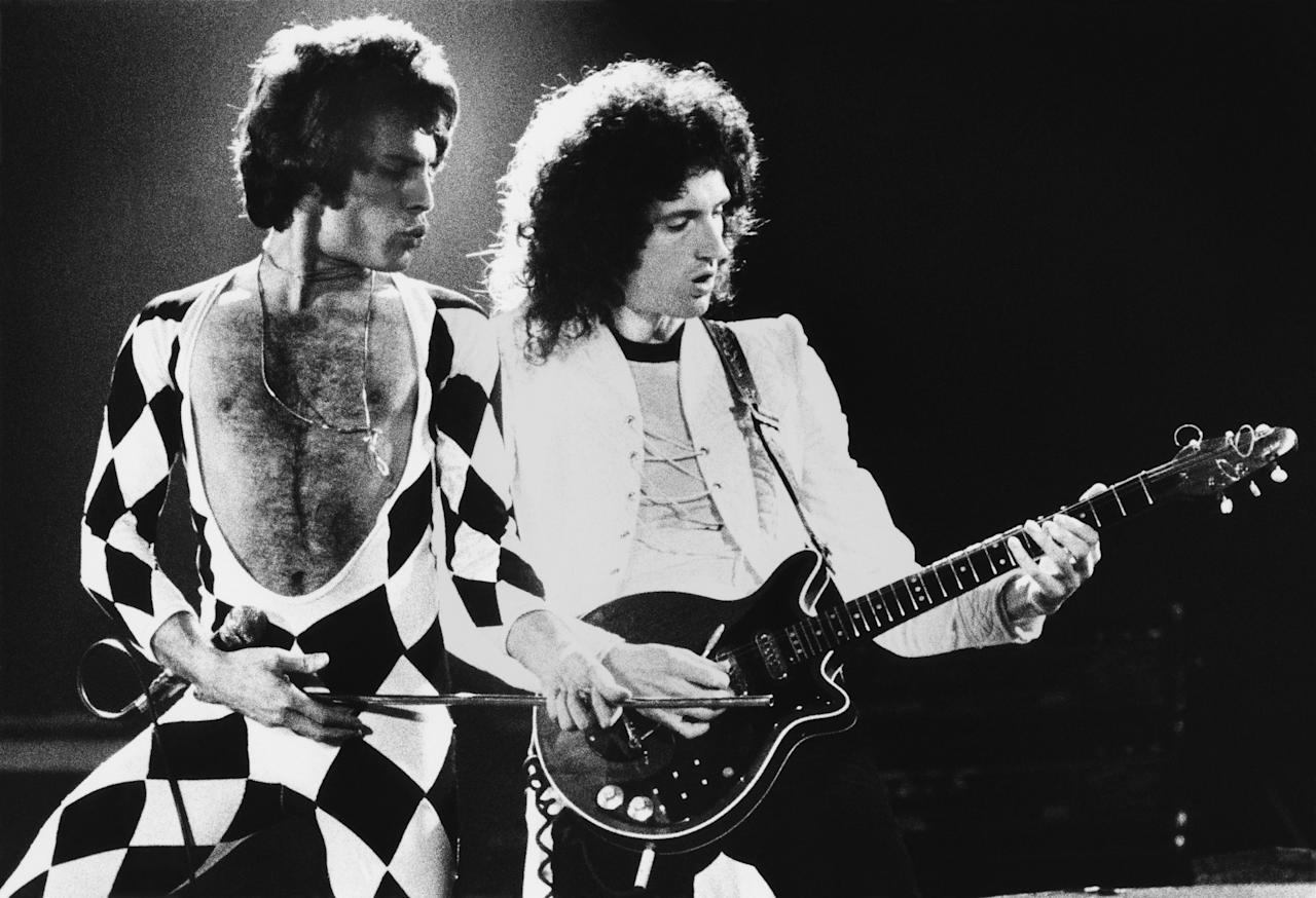 "INGLEWOOD, CA - 1978:  Singer Freddie Mercury and guitarist Brian May of the rock group Queen perform ""We Are The Champions"" onstage during a 1978 Inglewood, California, concert at the Forum. (Photo by George Rose/Getty Images)"