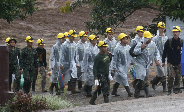 <p>Rescuers walk toward the entrance to the cave complex in Chiang Rai province, Thailand, on July 10, 2018. (Photo: Sakchai Lalit/AP) </p>