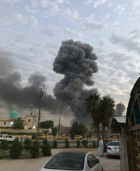 FILE - in this Monday, Aug. 12, 2019 file photo, plumes of smoke rise after an explosion at a military base southwest of Baghdad, Iraq. Israel was responsible for the bombing of an Iranian weapons depot in Iraq last month, U.S. officials have confirmed, an attack that would mark a significant escalation in Israel's long campaign against Iranian military entrenchment in the region. (AP Photo/Loay Hameed, File)
