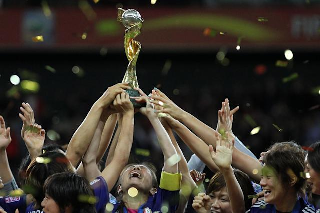 Homare Sawa lifts the World Cup for Japan at Germany 2011. (Photo by Sampics/Corbis via Getty Images)