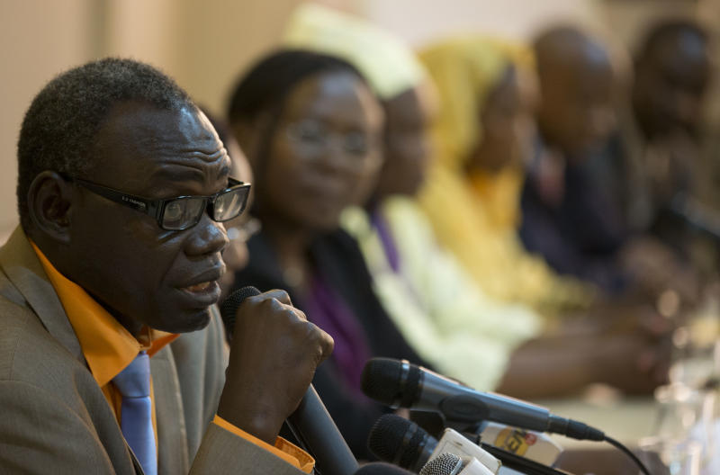 Clement Abaifouta, president of the association of victims of former Chadian dictator Hissene Habre, tells the story of his arrest and four years in prison, at a press conference in Dakar, Senegal, Wednesday, July 17, 2013. Abaifouta, arrested in 1985, said he was forced to dig graves for hundreds of prisoners, while his health deteriorated to the point where he was no longer able to walk. A lawyer said more than 1,000 victims of Habre have formally asked to participate in his trial on charges of war crimes, crimes against humanity and torture. (AP Photo/Rebecca Blackwell)