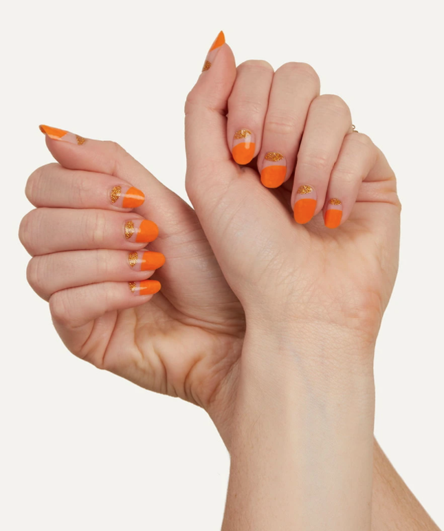 """<p>Not looking to go all out spooky, but still want to feel on theme for Halloween? Try these pretty tangerine/gold nail stickers that will look just as good the day after. </p><p><a class=""""link rapid-noclick-resp"""" href=""""https://manime.co/setup/product-detail?productId=4573482188909"""" rel=""""nofollow noopener"""" target=""""_blank"""" data-ylk=""""slk:SHOP NAIL STICKERS"""">SHOP NAIL STICKERS</a></p>"""