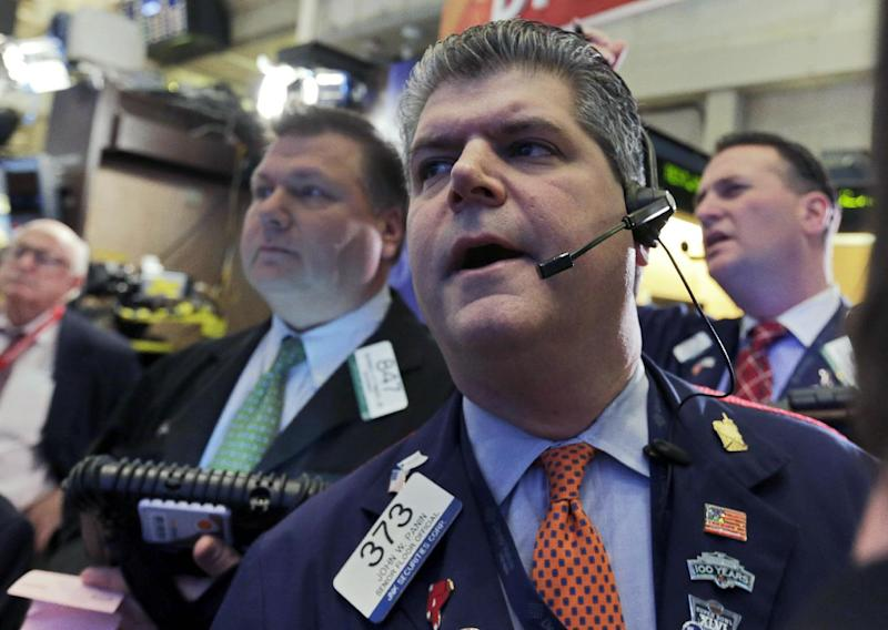FILE - In this Thursday,  Jan. 10, 20013, file photo, Trader John Panin, center, works on the floor of the New York Stock Exchange. Stocks on Wall Street, which was closed Monday for a public holiday, appeared set for gains Tuesday Jan. 22, 2013.  (AP Photo/Richard Drew, File)