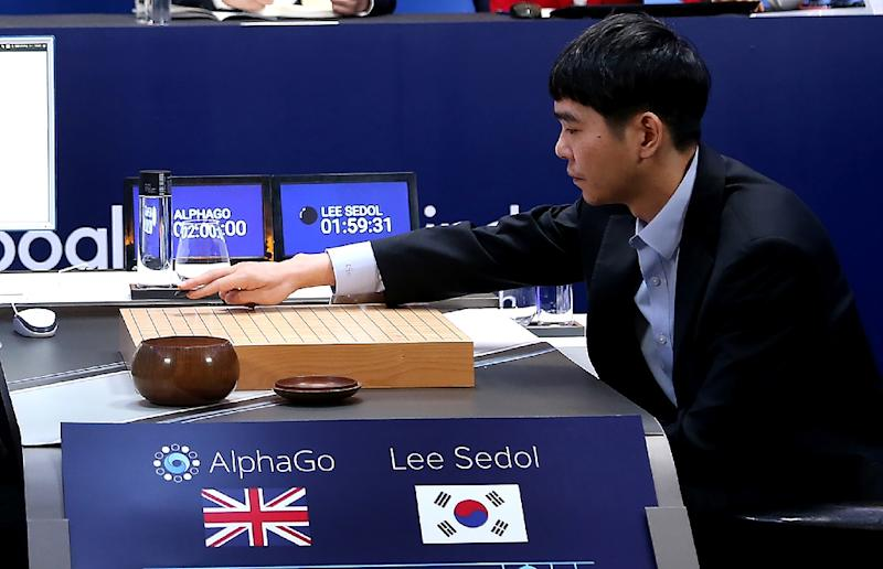 Lee Se-Dol, one of the greatest modern players of the ancient board game Go, makes a move during the Google DeepMind Challenge Match against supercomputer AlphaGo in Seoul on March 12, 2016 (AFP Photo/Google DeepMind)