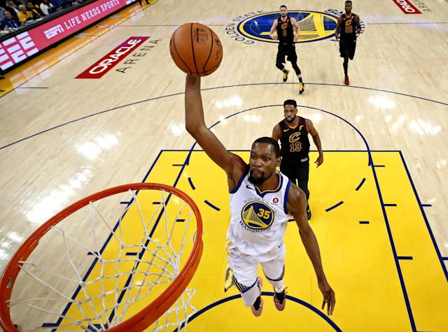 FILE PHOTO: May 31, 2018; Oakland, CA, USA; Golden State Warriors forward Kevin Durant (35) dunks the ball against Cleveland Cavaliers center Tristan Thompson (13) during the first half in game one of the 2018 NBA Finals at Oracle Arena. Mandatory Credit: Ezra Shaw/Pool Photo via USA TODAY/File Photo
