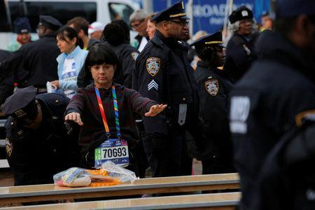 Athletics - New York City Marathon - New York, U.S. - November 5, 2017 - An entrant goes through a security check procedure conducted by police at the check-in area New York City Marathon. REUTERS/Andrew Kelly