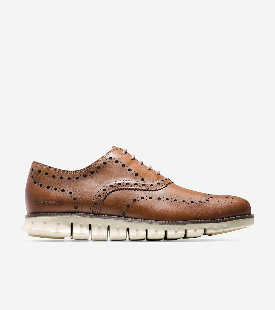 """<p>colehaan.com</p><p><strong>$190.00</strong></p><p><a href=""""https://go.redirectingat.com?id=74968X1596630&url=https%3A%2F%2Fwww.colehaan.com%2Fzerogrand-wingtip-oxford-british-tan%2FC14493.html&sref=https%3A%2F%2Fwww.menshealth.com%2Fstyle%2Fg36283507%2Fmens-dress-sneakers%2F"""" rel=""""nofollow noopener"""" target=""""_blank"""" data-ylk=""""slk:BUY IT HERE"""" class=""""link rapid-noclick-resp"""">BUY IT HERE</a></p><p>When you think of dress sneakers, the first brand that comes to mind is probably Cole Haan. Their ZERØGRAND wingtip oxford is, admittedly, more <a href=""""https://www.menshealth.com/style/g19545927/best-dress-shoes/"""" rel=""""nofollow noopener"""" target=""""_blank"""" data-ylk=""""slk:dress shoe"""" class=""""link rapid-noclick-resp"""">dress shoe</a> than sneaker, yet the footbed is still more comfortable than most sneakers out there. </p>"""