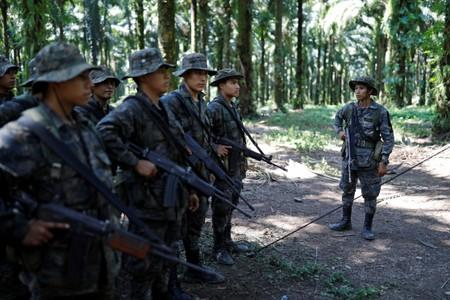 Soldiers stand in formation during a temporary state of siege, approved by the Guatemalan Congress following the death of several soldiers last week, in the community of Semuy II, Izabal province