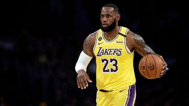 PHOTO: In this March 10, 2020, file photo, Los Angeles Lakers' LeBron James dribbles during the first half of an NBA basketball game against the Brooklyn Nets in Los Angeles. (Marcio Jose Sanchez/AP, File)