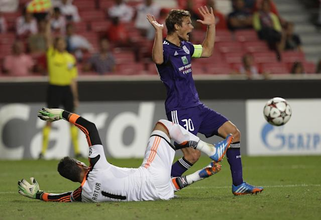 Anderlecht's Guillaume Gillet, right raises his arms in front of Benfica's goalkeeper Artur Moraes during the Champions League group C soccer match between Benfica and Anderlecht Tuesday, Sept. 17, 2013, at Benfica's Luz stadium in Lisbon. (AP Photo/Armando Franca)