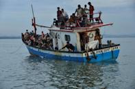 Refugees who made it to Indonesia told stories of beatings, near-starvation and threats to hold passengers hostage until their relatives paid more money