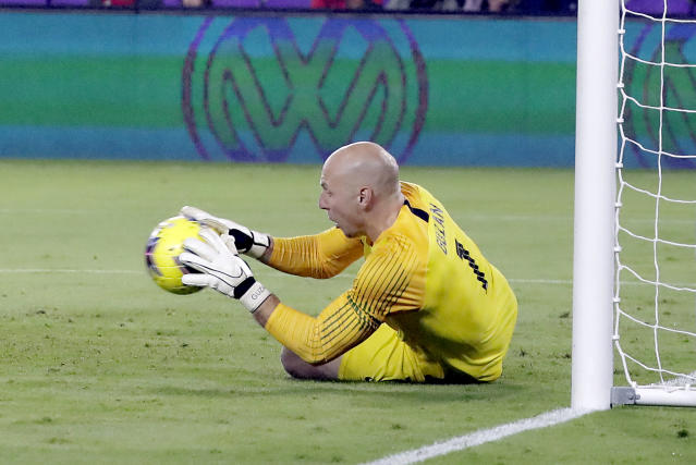 U.S. goalkeeper Brad Guzan blocks a shot during the first half of the team's CONCACAF Nations League soccer match against Canada on Friday, Nov. 15, 2019, in Orlando, Fla. (AP Photo/John Raoux)