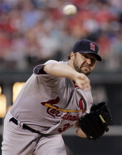 St. Louis Cardinals' Jake Westbrook follows through on a pitch in the first inning of a baseball game with the Philadelphia Phillies, Saturday, Aug. 11, 2012, in Philadelphia. (AP Photo/Tom Mihalek)