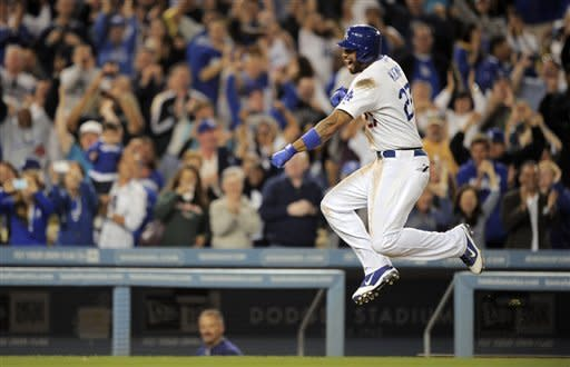 Los Angeles Dodgers' Matt Kemp celebrates after hitting a walk-off home run in the tenth inning of their baseball game agains the Washington Nationals, Saturday, April 28, 2012, in Los Angeles. The Nationals won 4-3. (AP Photo/Mark J. Terrill)