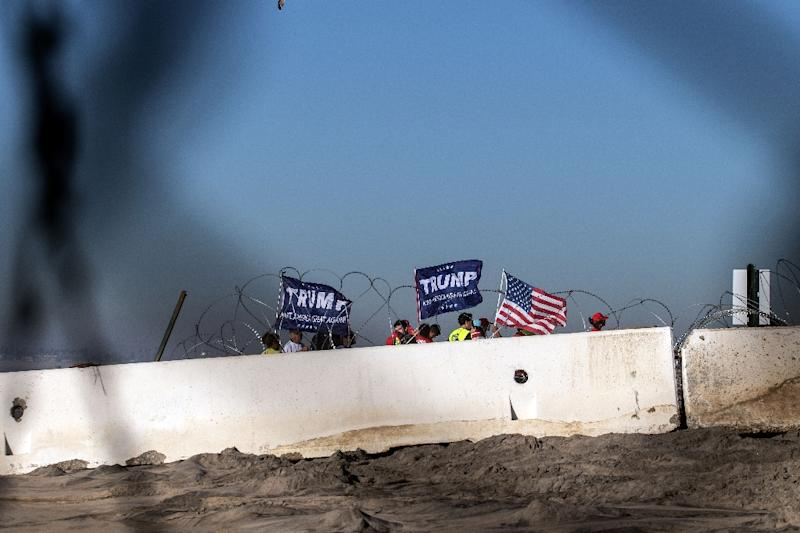 Pro-Trump demonstrators protest near the US-Mexico border in Imperial Beach, San Diego County (AFP Photo/Guillermo Arias)