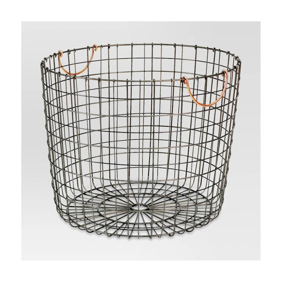 <p>Target's <span>Extra Large Round Wire Decorative Storage Bin With Handles</span> ($25) is perfect for storing throw blankets. </p>