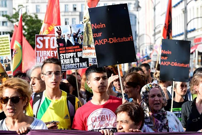 Members of Berlin's Turkish and Kurdish community march to protest against the military coup in Turkey on July 22 (AFP Photo/Tobias Schwarz)