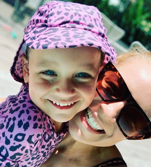 Carrie Bickmore with her daughter Evie at the beach