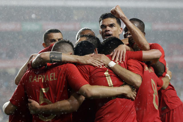 Portugal's Pepe, reacts as he celebrates with his teammates, his side's 3rd goal during a friendly soccer match between Portugal and Algeria in Lisbon, Portugal, Thursday, June 7, 2018. (AP Photo/Armando Franca)