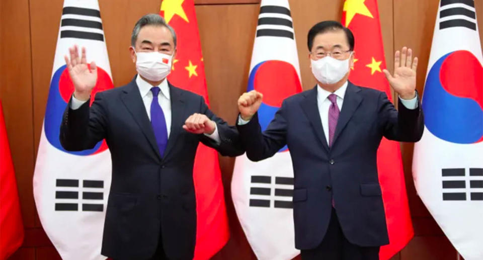 Chinese Foreign Minister Wang Yi, left, poses with his South Korean counterpart Chung Eui-yong at the Foreign Ministry in Seoul on Wednesday. Source: Kim Seung-doo/Yonhap via AP)