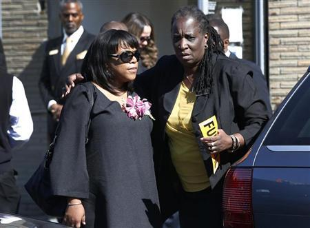 Valerie Carey is comforted by an unidentified woman outside the Grace Funeral Chapels in Brooklyn