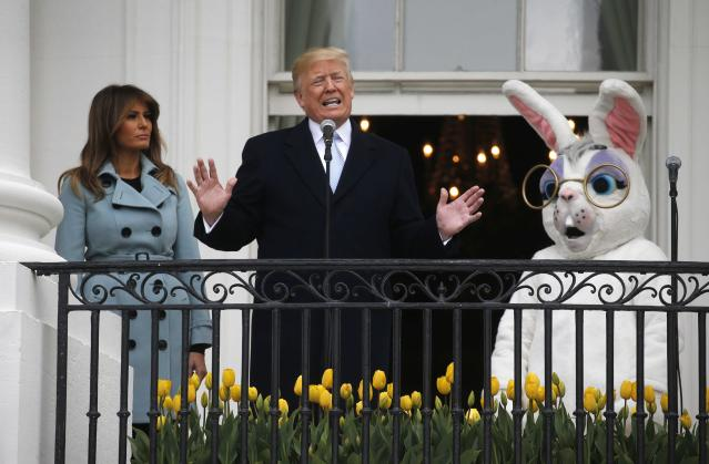 Trump speaks with first lady Melania Trump and the Easter Bunny at his sides at the annual White House Easter Egg Roll on Monday. (Leah Millis/Reuters)