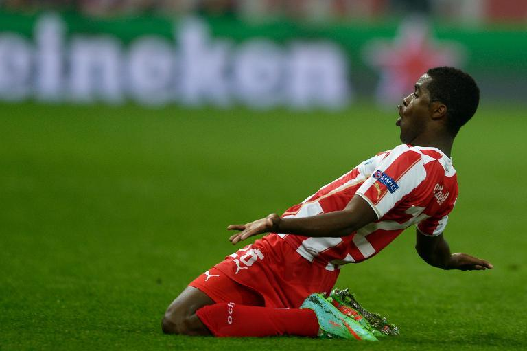 Olympiakos' Costa Rican midfielder Joel Campbell celebrates after scoring during the round of 16 Champions League football match Olympiakos vs Manchester United at Karaiskaki Stadium in Athens on February 25, 2014