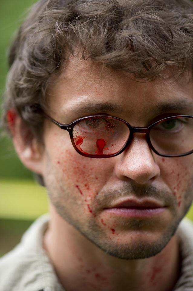 <p>Somebody get this guy a lens cloth. Graham gets a bit of blood spatter on his eyeglasses (and all over his face) during an investigation.</p>