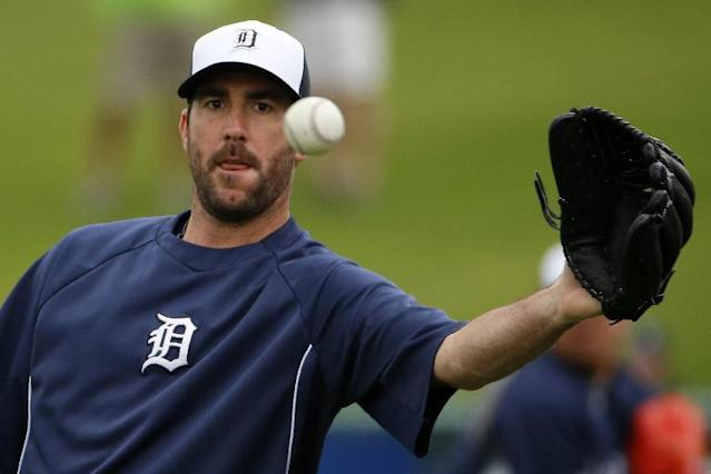 Detroit Tigers pitcher Justin Verlander catches a ball while throwing long toss with teammate Max Scherzer before an exhibition spring training baseball game in Lakeland, Fla., Thursday, Feb. 27, 2014. (AP Photo/Gene J. Puskar)