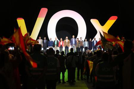 Santiago Abascal, leader of far-right political party VOX, stands with other party members at the end of a rally at the Palacio Vistalegre pavilion in Madrid, Spain, October 7, 2018. REUTERS/Stringer