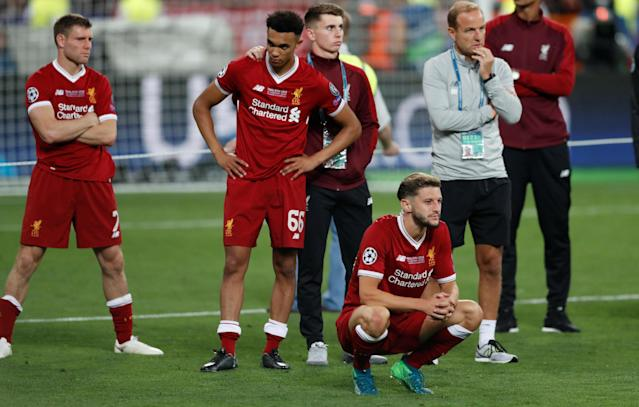Soccer Football - Champions League Final - Real Madrid v Liverpool - NSC Olympic Stadium, Kiev, Ukraine - May 26, 2018 Liverpool's James Milner, Trent Alexander-Arnold and Adam Lallana look dejected after the match REUTERS/Andrew Boyers