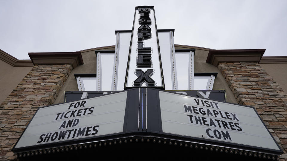\The Megaplex Luxury Theatres are shown Monday, Aug. 31, 2020, in Holladay, Utah. Voting will look a little different this November. States are considering drive-thrus, outdoor polling places and curbside voting as they examine creative ways to safely offer same-day polling places during a pandemic. (AP Photo/Rick Bowmer)