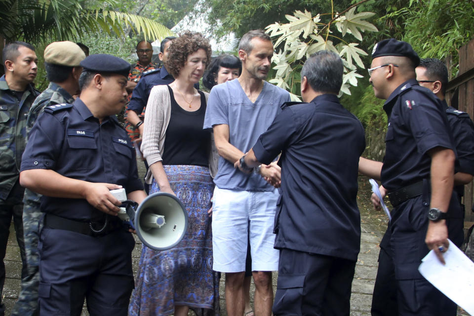 Sebastien and Meabh Quoirin with police officers in Malaysia.