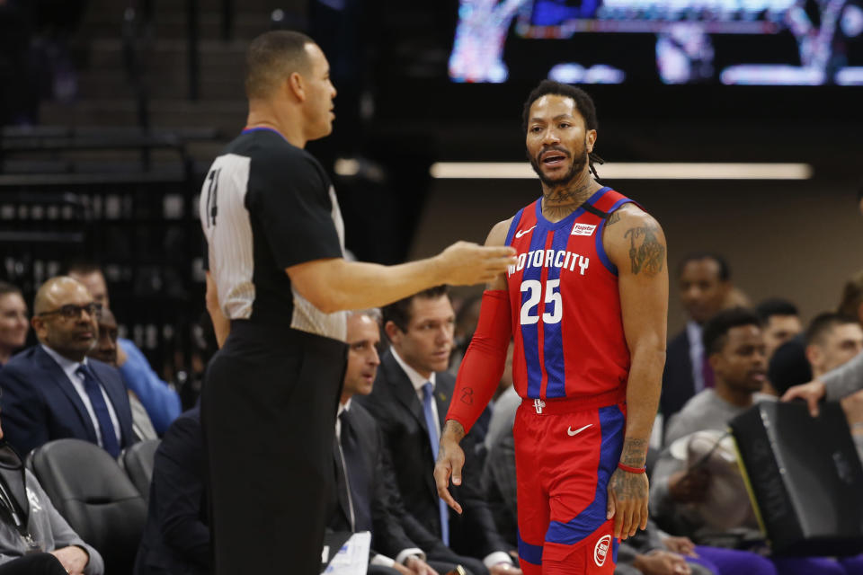 Detroit Pistons guard Derrick Rose, right questions referee Curtis Blair, left, about a foul call during the first half of an NBA basketball game against the Sacramento Kings in Sacramento, Calif., Sunday, March 1, 2020. (AP Photo/Rich Pedroncelli)