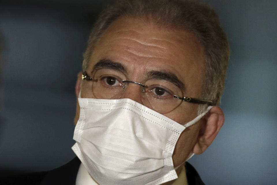 Brazil's Health Minister Marcelo Queiroga arrives to testify before the Senate during an investigation of the government's management of the COVID-19 pandemic, in Brasilia, Brazil, Tuesday, June 8, 2021. (AP Photo/Eraldo Peres)