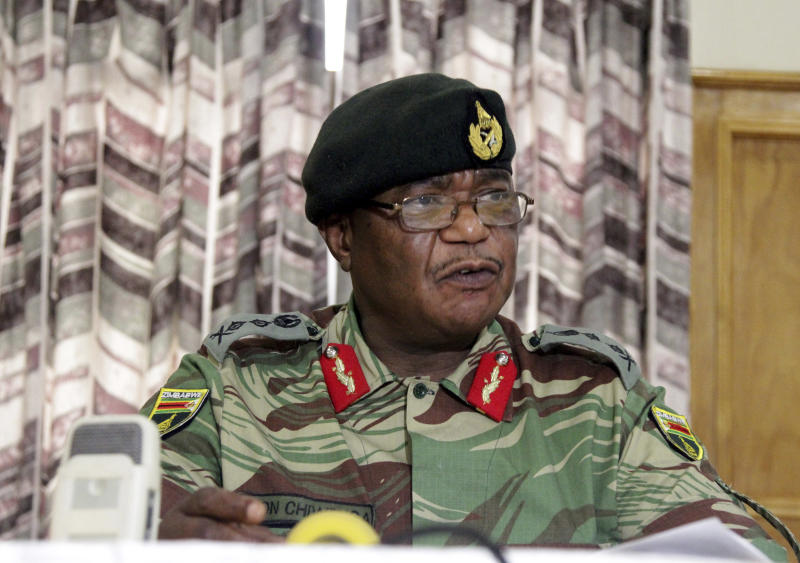 The Latest: Zimbabwe's war vets praise army's actions