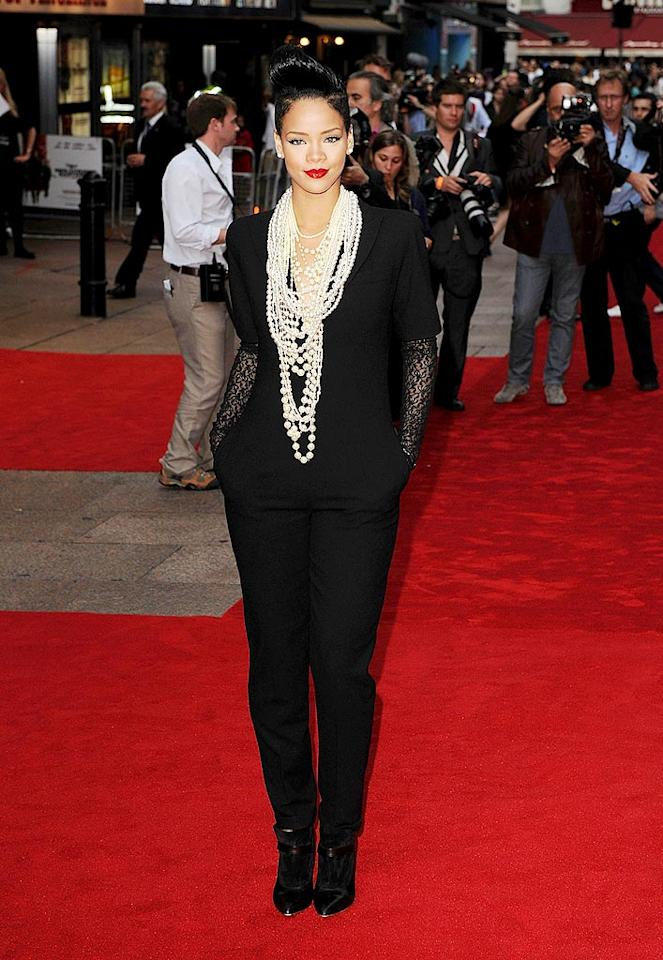 "Meanwhile, Rihanna channeled Madonna at the British debut of Quentin Tarantino's latest film, ""Inglourious Basterds."" Her black Alexander McQueen jumpsuit, layered pearls, lace fingerless gloves, dark shades, and matching Maison Martin Margiela heels were undoubtedly Material Girl-inspired. Eamonn McCormack/<a href=""http://www.wireimage.com"" target=""new"">WireImage.com</a> - July 23, 2009"