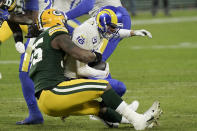 Green Bay Packers' Za'Darius Smith (55) sacks Los Angeles Rams quarterback Jared Goff (16) during the first half of an NFL divisional playoff football game Saturday, Jan. 16, 2021, in Green Bay, Wis. (AP Photo/Morry Gash)