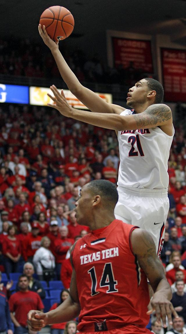 Arizona's Brandon Ashley (21) goes up for a shot as Texas Tech's Robert Turner (14) watches in the first half of an NCAA college basketball game on Tuesday, Dec. 3, 2013, in Tucson, Ariz. (AP Photo/John MIller)