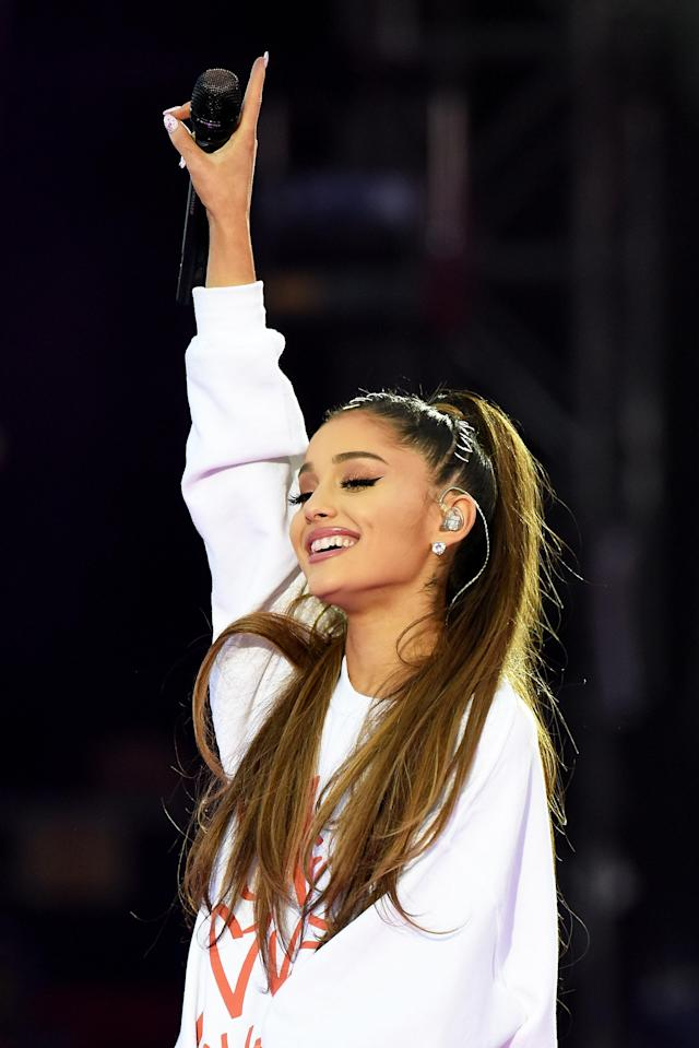 The pop star typically wears her dark hair in a high ponytail. (Photo: Getty Images/Dave Hogan for One Love Manchester)