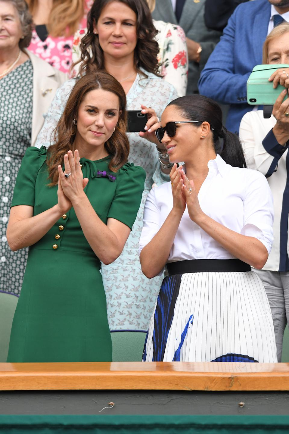 The sisters-in-law watched Meghan's friend Serena Williams play on day 12 of the tennis championships. <em>[Photo: Getty]</em>